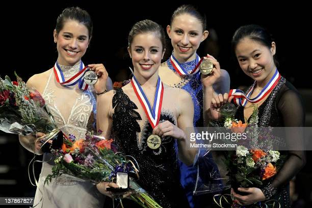 Alissa Czisny Ashley Wagner Agnes Zawadzki and Caroline Zhang pose for photographers on the medal's podium after the Ladies competition during the...