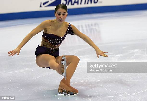 Alissa Czisny falls while competing in the Women's Free program during the 2006 State Farm U.S. Figure Championships at the Savvis Center on January...