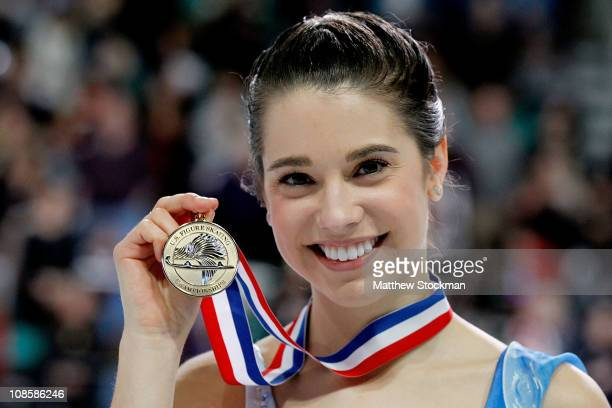 Alissa Czisny poses for photographers after the Championship Ladies competition during the US Figure Skating Championships at the Greensboro Coliseum...