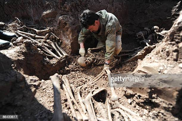 Alissa DE CARBONNEL A Russian WWII history enthusiast excavates the site of a mass grave for unidentified Soviet soldiers that were killed during...