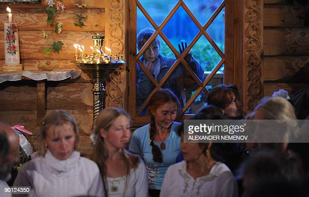 Alissa DE CARBONNEL A small boy watches as followers of 'Vissarion the Teacher' or 'Jesus of Siberia' Russian extraffic cop Sergei Torop attend a...