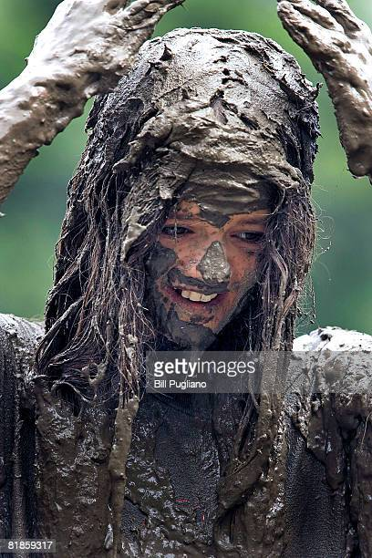 Alissa Edwards age 12 of Livonia Michigan gives herself a mud hairdoo at the annual Mud Day celebration July 8 2008 in Westland Michigan Sponsored by...