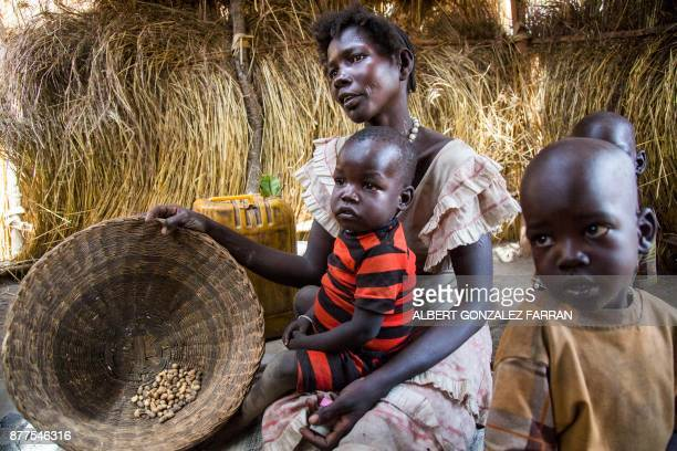 Alissa Lual a displaced mother of three children shows the stock of food in her shelter at an Internally Displaced Person camp formed by local...
