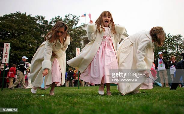 Alissa Miller of Phoenix Arizona cheers during the annual Easter Egg Roll on the South Lawn of the White House March 24 2008 in Washington DC The...