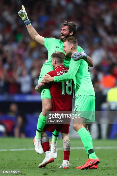 Alisson Alberto Moreno and Simon Mignolet of Liverpool celebrate at the final whistle following the UEFA Champions League Final between Tottenham...