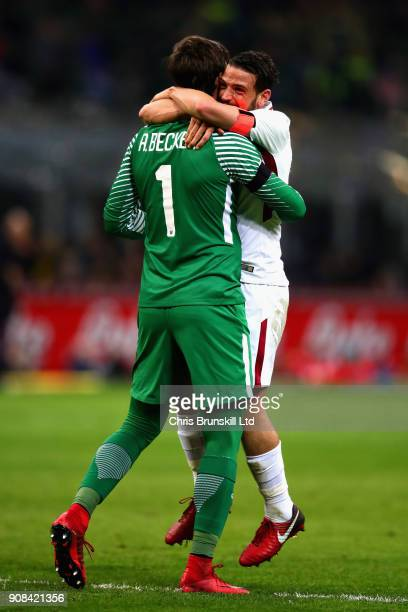 Alisson and Alessandro Florenzi both of AS Roma celebrate their sides first goal during the Serie A match between FC Internazionale and AS Roma at...