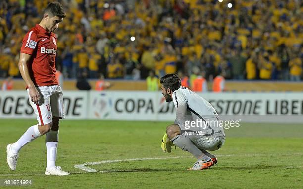 Alisson and Alex of Internacional look dejected after a semifinal second leg match between Tigres UANL and Internacional as part of Copa Bridgestone...