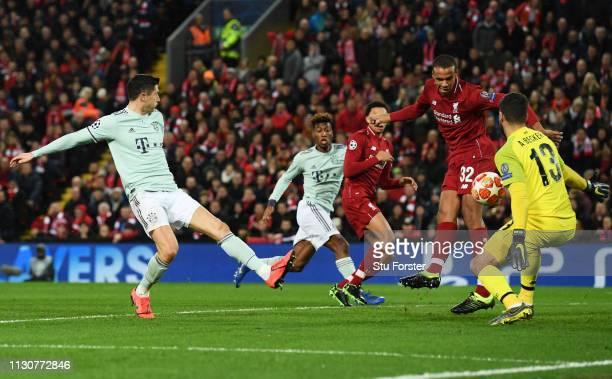 Alisson and Joel Matip of Liverpool block from Robert Lewandowski of Bayern Munich during the UEFA Champions League Round of 16 First Leg match...