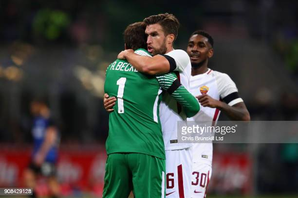 Alisson and Kevin Strootman both of AS Roma celebrate their sides first goal during the Serie A match between FC Internazionale and AS Roma at Stadio...
