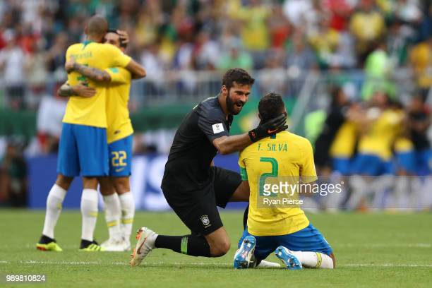 Alisson and Thiago Silva of Brazil celebrate victory following the 2018 FIFA World Cup Russia Round of 16 match between Brazil and Mexico at Samara...