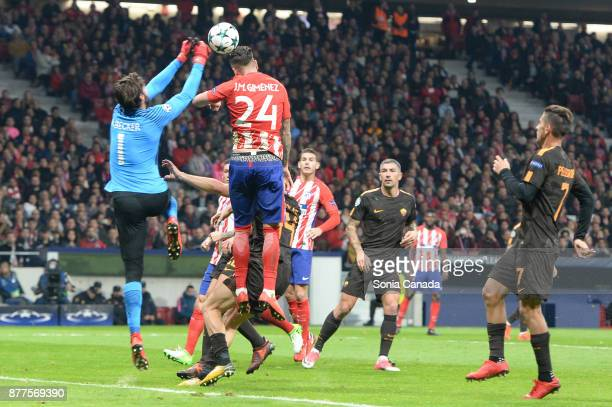 Alisson Becker #1 of AS Roma and Jose Maria Gimenez de Vargas #24 of Atletico de Madrid during the UEFA Champions League group C match between Club...