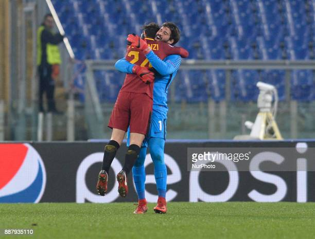 Alisson Becker and Alessandro Florenzi exults during the Champions League football match AS Roma vs Qarabag at the Olympic Stadium in Rome on...