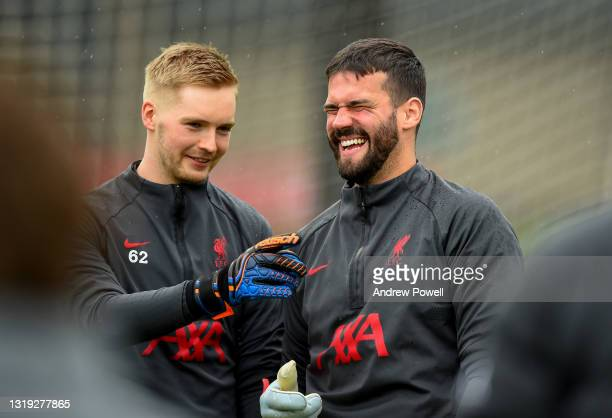 Alisson Becker and Caoimhin Kelleher of Liverpool during a training session at AXA Training Centre on May 21, 2021 in Kirkby, England.