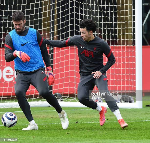 Alisson Becker and Curtis Jones of Liverpool during a training session at AXA Training Centre on April 28, 2021 in Kirkby, England.