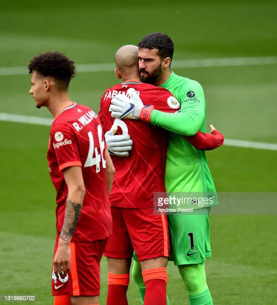 Alisson Becker and Fabinho of Liverpool during the Premier League match between Liverpool and Crystal Palace at Anfield on May 23, 2021 in Liverpool,...
