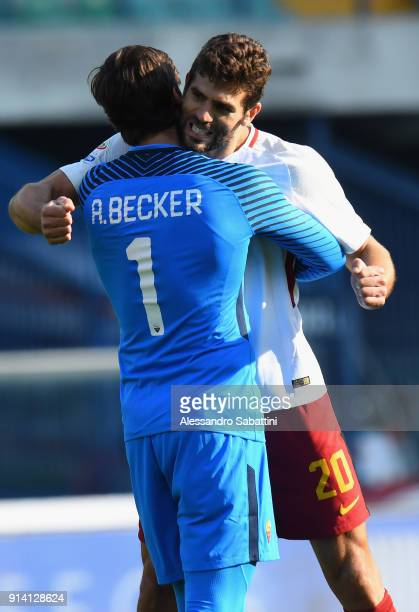 Alisson Becker and Federico Fazio of AS Roma celebrate the victory after the serie A match between Hellas Verona FC and AS Roma at Stadio...