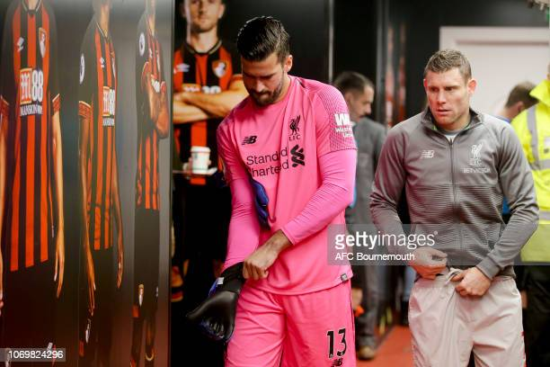 Alisson Becker and James Milnerof Liverpool in the tunnel before the Premier League match between AFC Bournemouth and Liverpool FC at Vitality...