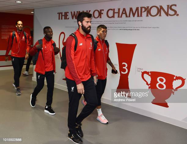 Alisson Becker and Roberto Firmino of Liverpool arrive before the Premier League match between Liverpool FC and West Ham United at Anfield on August...