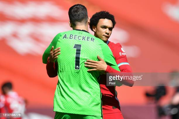 Alisson Becker and Trent Alexander-Arnold of Liverpool embrace prior to the Premier League match between Liverpool and Newcastle United at Anfield on...