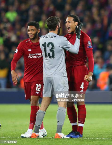 Alisson Becker and Virgil van Dijk of Liverpool celebrate after the UEFA Champions League Semi Final second leg match between Liverpool and Barcelona...
