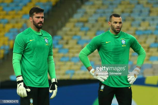 Alisson Becker and Weverton of Brazil warm up prior to the final of Copa America Brazil 2021 between Brazil and Argentina at Maracana Stadium on July...
