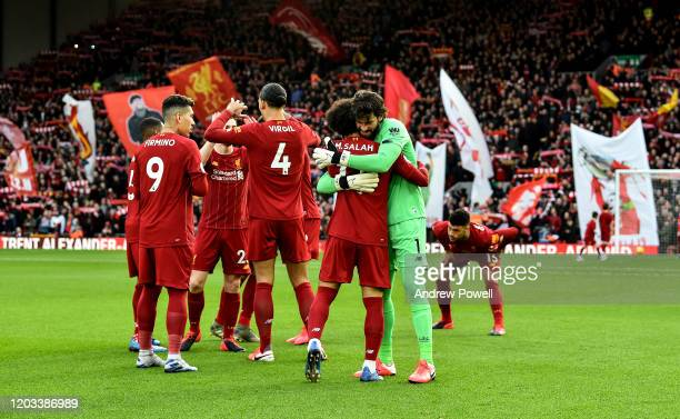 Alisson Becker embracing Mohamed Salah of Liverpool before the Premier League match between Liverpool FC and Southampton FC at Anfield on February...