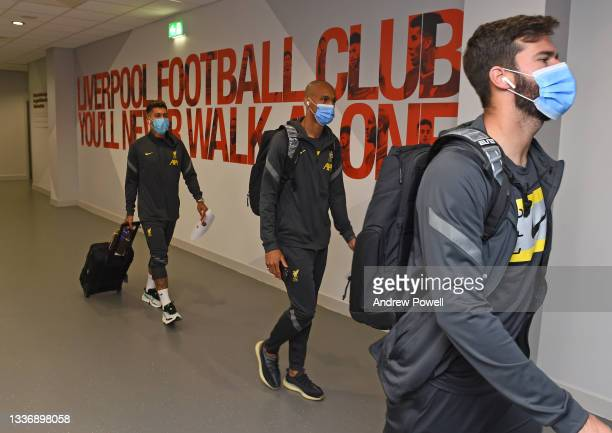 Alisson Becker, Fabinho and Roberto Firmino of Liverpool arriving before the Premier League match between Liverpool and Chelsea at Anfield on August...