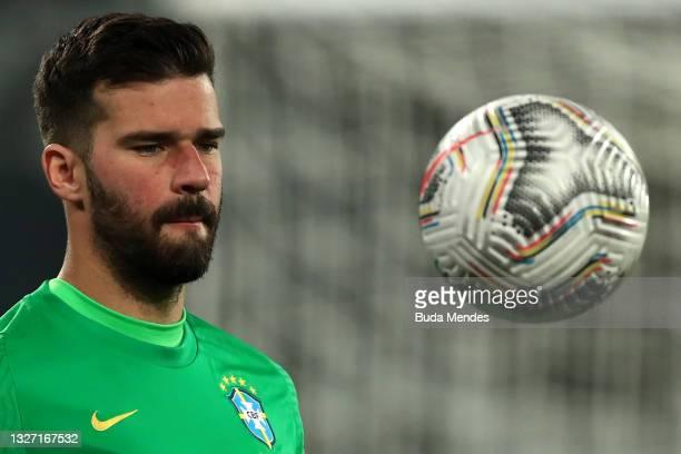 Alisson Becker goalkeeper of Brazil looks at the ball before a semi-final match of Copa America Brazil 2021 between Brazil and Peru at Estadio...