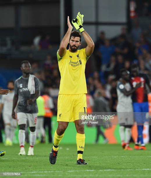 Alisson Becker goalkeeper of Liverpool greets the fans at the end of the Premier League match between Crystal Palace and Liverpool FC at Selhurst...