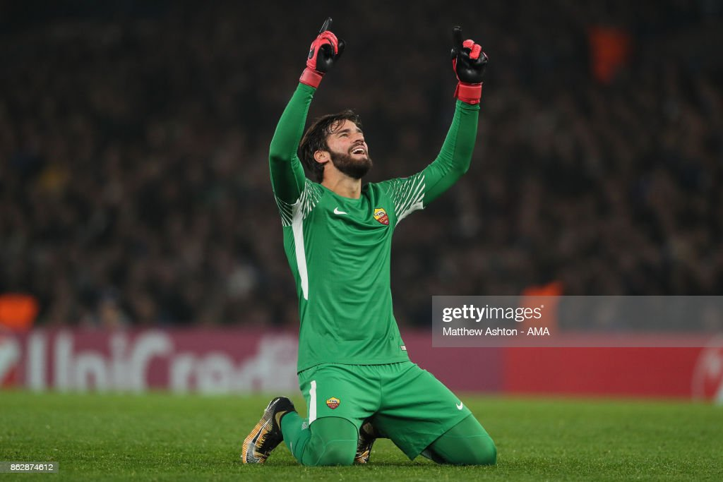 Alisson Becker of AS Roma celebrates after Edin Dzeko of AS Roma scores a goal to make it 2-2 during the UEFA Champions League group C match between Chelsea FC and AS Roma at Stamford Bridge on October 18, 2017 in London, United Kingdom.