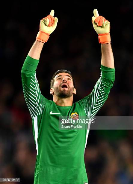 Alisson Becker of AS Roma celebrates his sides first goal during the UEFA Champions League Quarter Final Leg One match between FC Barcelona and AS...