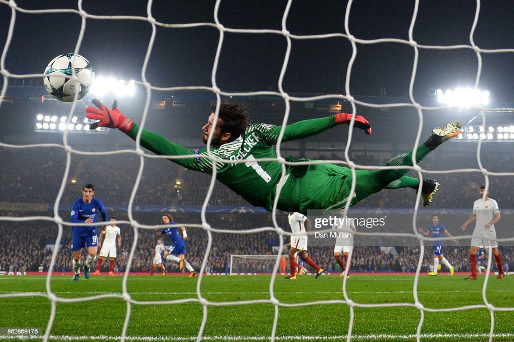 Alisson Becker of AS Roma dives but fails to stop David Luiz of Chelsea (obscure) shot from going in for Chelsea first goal during the UEFA Champions League group C match between Chelsea FC and AS Roma at Stamford Bridge on October 18, 2017 in London, United Kingdom.
