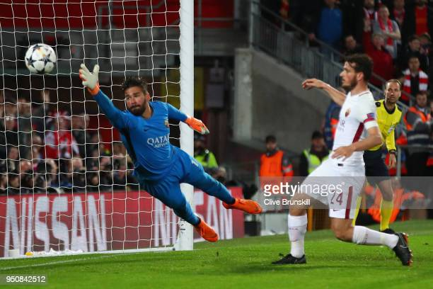 Alisson Becker of AS Roma fails to stop Roberto Firmino of Liverpool as he scores his sides fifth goal during the UEFA Champions League Semi Final...