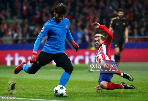 Alisson Becker of AS Roma is put under pressure by Antoine Griezmann of Atletico Madrid during the UEFA Champions League group C match between...