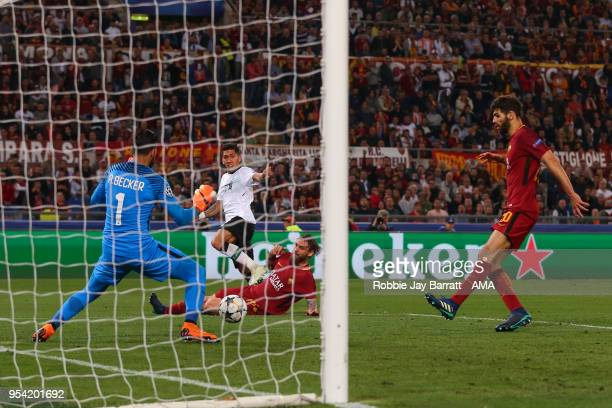 Alisson Becker of AS Roma saves a shot from Roberto Firmino of Liverpool during the UEFA Champions League Semi Final Second Leg match between AS Roma...