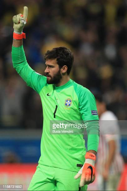 Alisson Becker of Brazil celebrates after saving a penalty during the shootout after the Copa America Brazil 2019 quarterfinal match between Brazil...