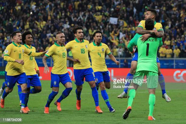 Alisson Becker of Brazil celebrates with teammate Gabriel Jesus winning in the penalty shootout after the Copa America Brazil 2019 quarterfinal match...