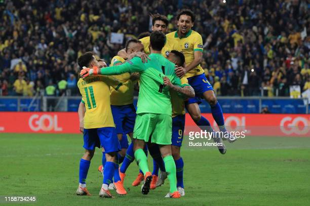 Alisson Becker of Brazil celebrates with teammates winning in the penalty shootout after the Copa America Brazil 2019 quarterfinal match between...
