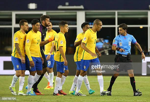 Alisson Becker of Brazil Miranda and teammates plead their case to an official in the second half during the 2016 Copa America Centenario Group B...