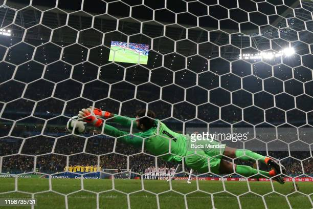 Alisson Becker of Brazil saves the penalty kick of Gustavo Gomez of Paraguay during shootout after the Copa America Brazil 2019 quarterfinal match...