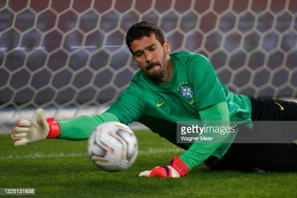 Alisson Becker of Brazil warms up prior to a Group B match between Brazil and Colombia as part of Copa America Brazil 2021 at Estadio Olímpico Nilton...