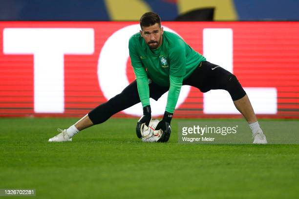 Alisson Becker of Brazil warms up prior to a quarterfinal match between Brazil and Chile as part of Copa America Brazil 2021 at Estadio Olímpico...