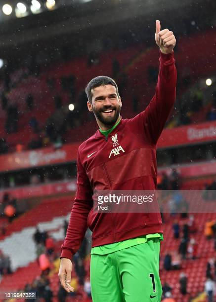 Alisson Becker of Liverpool acknowledges the fans following the Premier League match between Liverpool and Crystal Palace at Anfield on May 23, 2021...