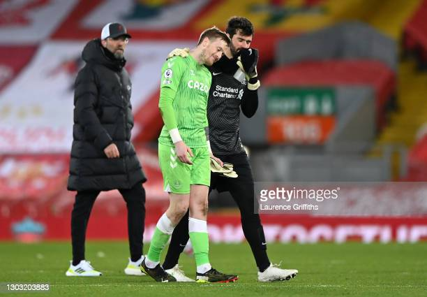 Alisson Becker of Liverpool and Jordan Pickford of Everton interact following the Premier League match between Liverpool and Everton at Anfield on...