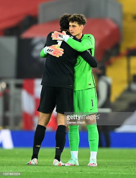 Alisson Becker of Liverpool and Kepa Arrizabalaga of Chelsea embrace following the Premier League match between Liverpool FC and Chelsea FC at...