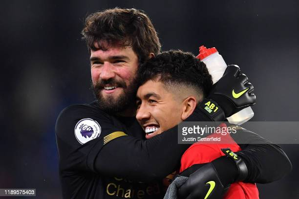Alisson Becker of Liverpool and Roberto Firmino of Liverpool celebrate after the Premier League match between Crystal Palace and Liverpool FC at...