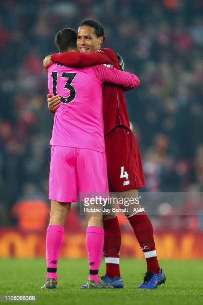 Alisson Becker of Liverpool and Virgil van Dijk of Liverpool celebrate at full time during the Premier League match between Liverpool FC and Watford...