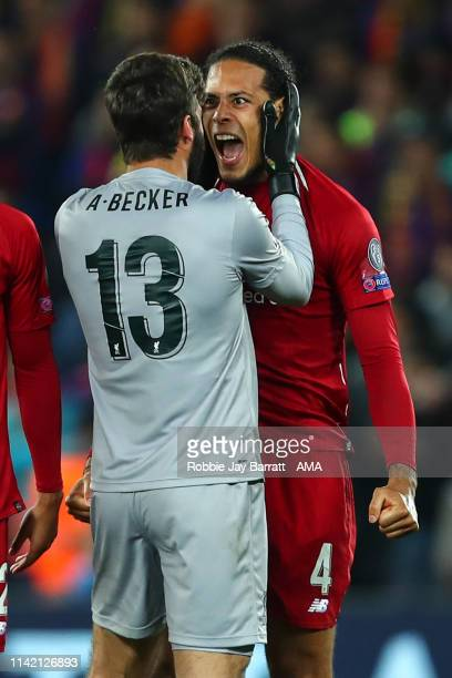 Alisson Becker of Liverpool and Virgil van Dijk of Liverpool celebrate at full time during the UEFA Champions League Semi Final second leg match...