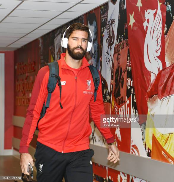 Alisson Becker of Liverpool arrives before the Premier League match between Liverpool FC and Manchester City at Anfield on October 6 2018 in...