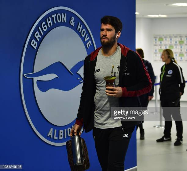 Alisson Becker of Liverpool arrives before the Premier League match between Brighton Hove Albion and Liverpool FC at American Express Community...